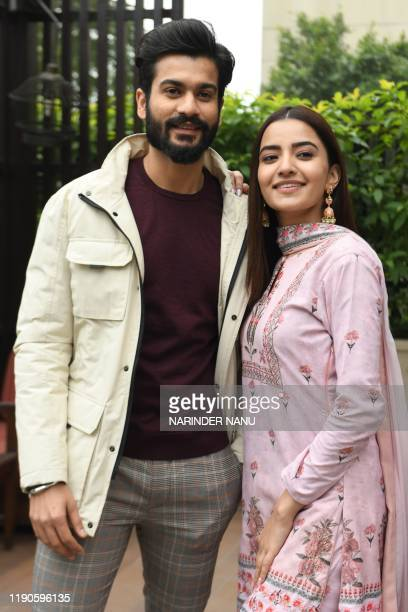 In this photo taken on December 26 Bollywood actors Sunny Kaushal and Rukshar Dhillonpose for pictures during the promotion of the upcomingfilm...