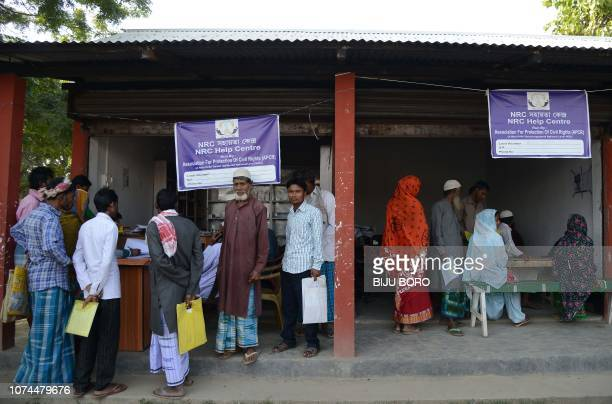 In this photo taken on December 8 villagers gather to check their documents at a National Register of Citizens help centre for people whose names...