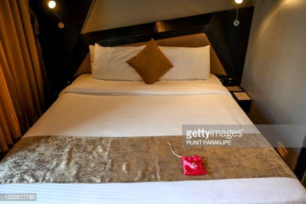 In this photo taken on February 10, 2020 a 'love kit' is seen on the bed in a room at the Dragonfly hotel in Mumbai. - Check in by the hour, bring...