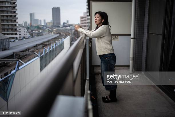 In this photo taken on February 11 Kazuko Nihei who fled her home in Fukushima city with her two daughters after a 2011 earthquake and tsunami...
