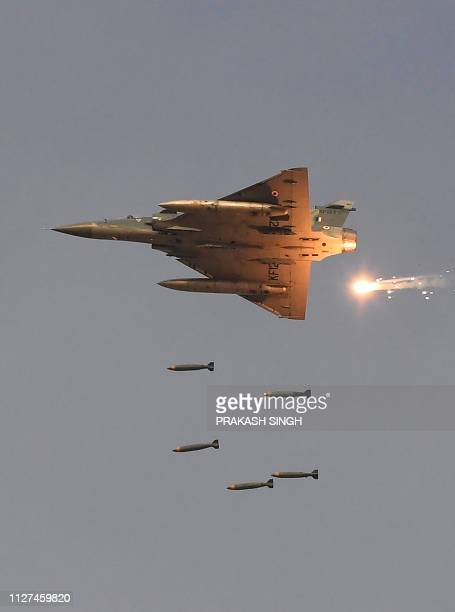 In this photo taken on February 16 an Indian Air Force Mirage2000 fighter aircraft drops bombs during the 'Vayu Shakti 2019' fire power demonstration...