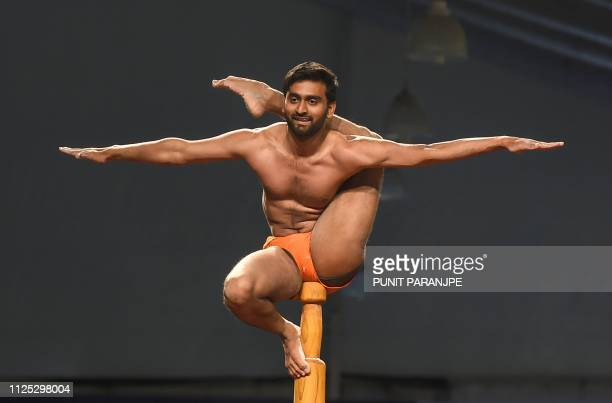 TOPSHOT In this photo taken on February 16 an Indian gymnast performs at the Mallakhamb World Championships in Mumbai Some 100 competitors from 15...