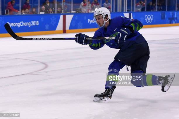 In this photo taken on February 17 2018 Slovenia's Ziga Jeglic scores the gamewinning goal against Slovakia during a penaltyshot shootout in the...