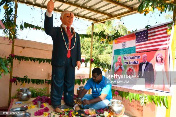 In this photo taken on February 17 farmer Bussa Krishna gives offerings to the statue of US President Donald Trump at his residence in Jangaon...