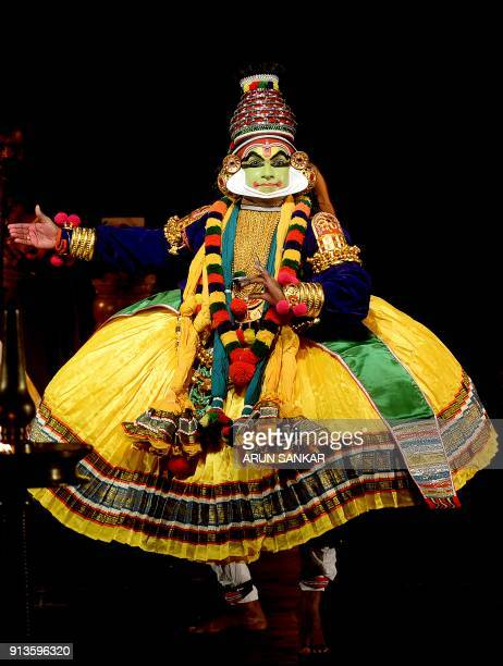 In this photo taken on February 2 2018 an Indian Kathakali artist performs during a show at a cultural festival at Kalakshetra Art Village in Chennai...
