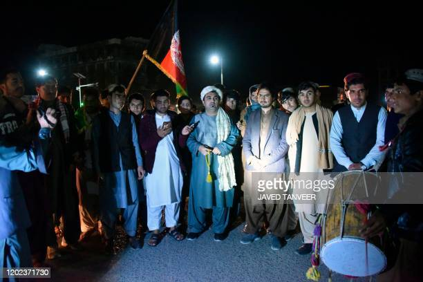 In this photo taken on February 21 youths and peace activists gather as they celebrate the reduction in violence in Kandahar A weeklong partial truce...