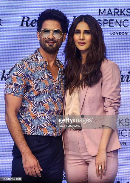 In this photo taken on February 7 Indian Bollywood actor Shahid Kapoor and actress Vaani Kapoor pose for photographs on stage for the launch of Marks...