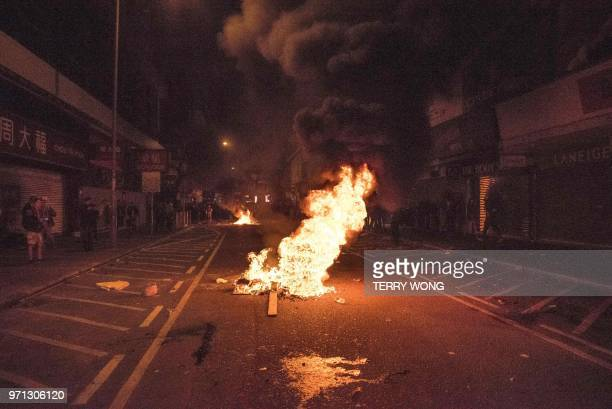 In this photo taken on February 9 a fire started by protesters burns in the street during clashes with police later dubbed the Fishball Revolution in...