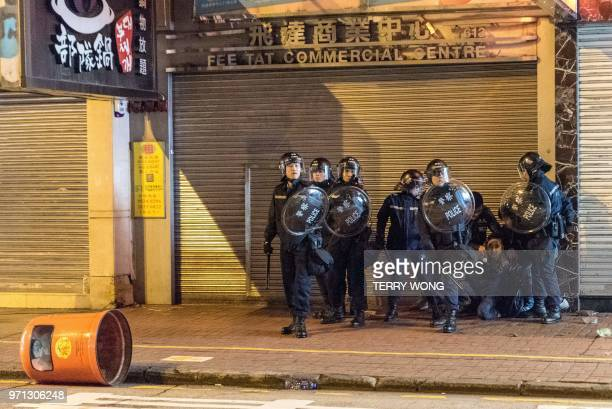 In this photo taken on February 9 a group of police arrest a protestor during clashes later dubbed the Fishball Revolution in the Mongkok area of...