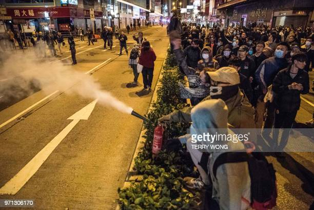In this photo taken on February 9 a protester uses a fire extinguisher during clashes with police later dubbed the Fishball Revolution in the Mongkok...