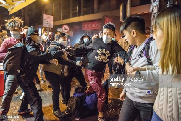 TOPSHOT In this photo taken on February 9 an altercation takes place during clashes between protesters and police later dubbed the Fishball...