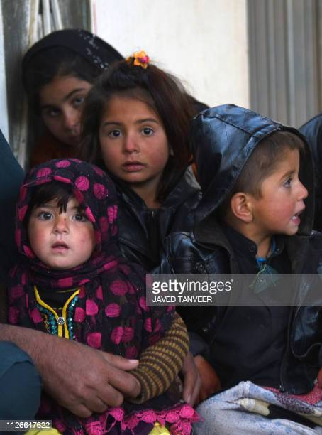In this photo taken on February 9 internally displaced Afghan children look on in Kandahar city after fleeing conflict with the Taliban in the Deh...