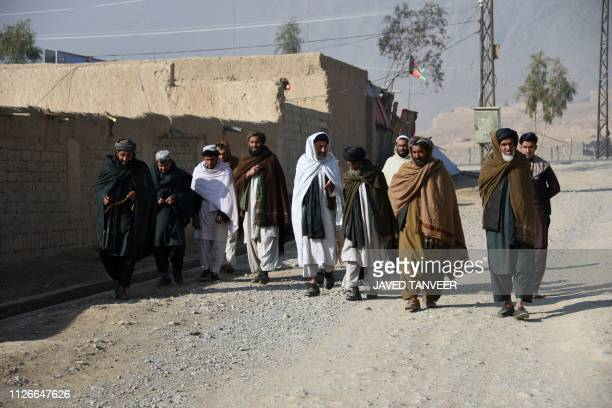 In this photo taken on February 9 internally displaced Afghan men walk in Kandahar city after fleeing conflict with the Taliban in the Deh Rawood...