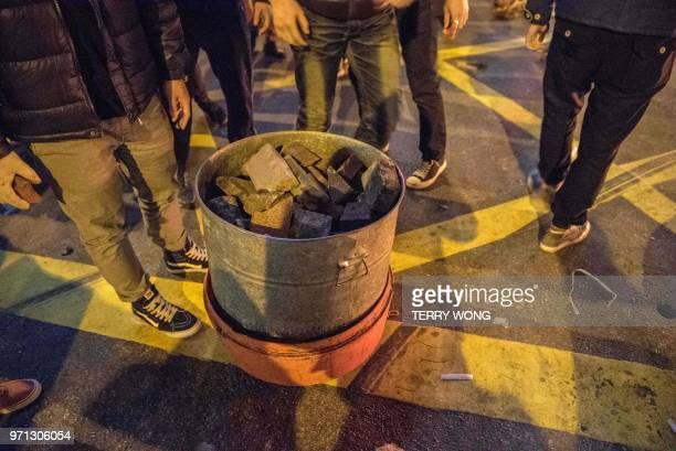 In this photo taken on February 9 loose bricks and stones are seen in a bin surrounded by protesters during clashes with police later dubbed the...