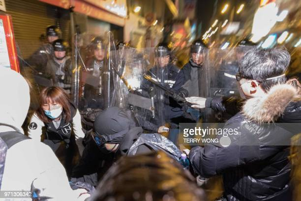 In this photo taken on February 9 police clash with protesters during demonstrations later dubbed the Fishball Revolution in the Mongkok area of Hong...