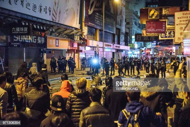 In this photo taken on February 9 protesters and police clash on a street during demonstrations later dubbed the Fishball Revolution in the Mongkok...