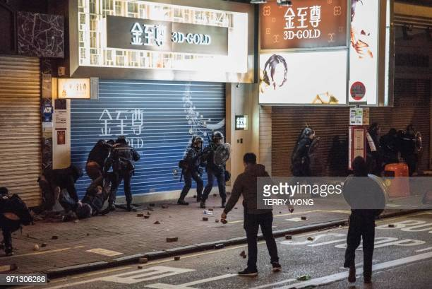 In this photo taken on February 9 protesters clash with police during demonstrations later dubbed the Fishball Revolution in the Mongkok area of Hong...