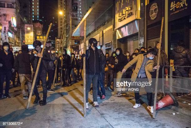 In this photo taken on February 9 protesters hold pieces of bamboo during clashes with police later dubbed the Fishball Revolution in the Mongkok...