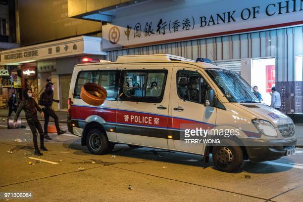 In this photo taken on February 9 protesters throw objects at a police van during clashes later dubbed the Fishball Revolution in the Mongkok area of...