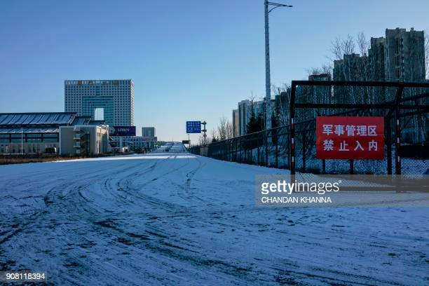 In this photo taken on January 11 the entrance to a fourlane 350 million USD bridge with a new customs zone is seen over the Yalu river leading to...
