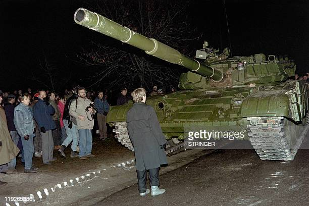 In this photo taken on January 13 a Lithuanian demonstrator stands in front of a Soviet Red Army tank during the assault on the Lithuanian Radio and...