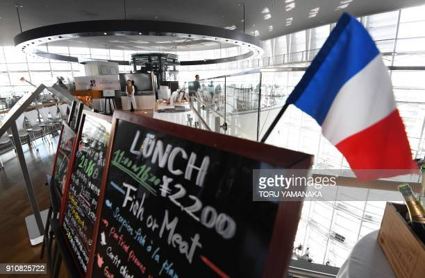 In this photo taken on January 25 menu boards showing the day's lunch specials are seen at the entrace to the 'Brasserie Paul Bocuse Le Musee' in the...