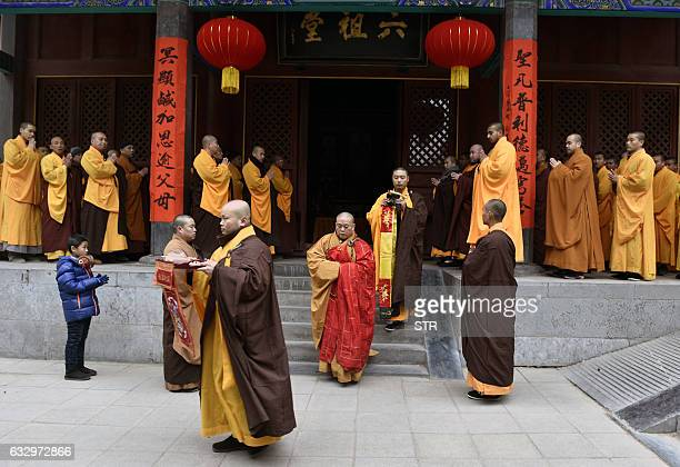In this photo taken on January 28 Chinese monks attend a ceremony at a Shaolin Temple the birthplace of Chinese Buddhism to celebrate the Lunar New...