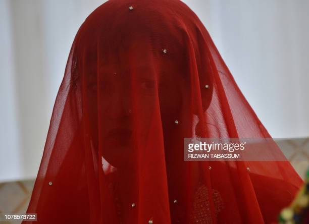 In this photo taken on January 6 2019 a Pakistani Hindu bridge looks on as he attends a mass wedding ceremony in Karachi The Pakistan Hindu Council a...
