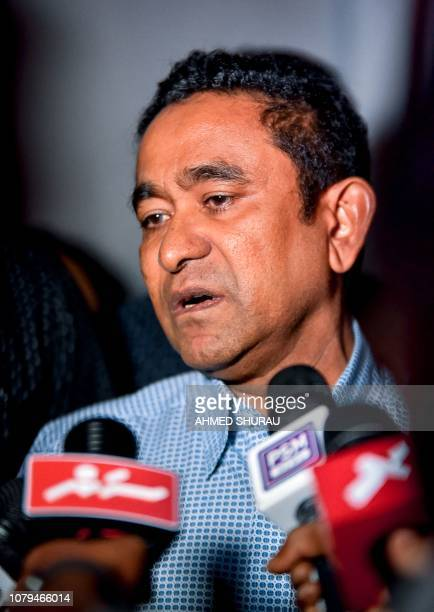 In this photo taken on January 8 2019 Maldives' former president Abdulla Yameen speaks to the media outside a police station where he had been...