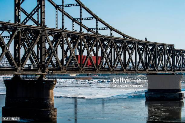 In this photo taken on January 9 a truck returns over the Friendship Bridge from the North Korean town of Sinuiju to the Chinese border city of...