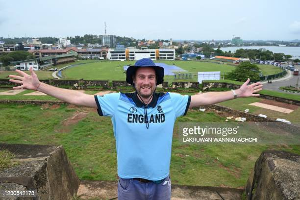 In this photo taken on January 9 English member of the Barmy Army fan group Rob Lewis gestures while posing for pictures during an interview with AFP...