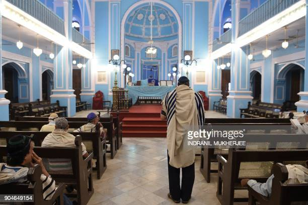In this photo taken on January 9 members of the Indian Jewish community attend a morning prayer service at the Magen David Synagogue in Mumbai...