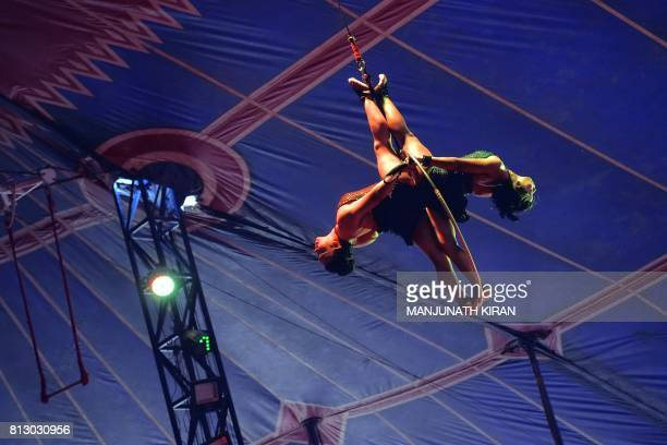 In this photo taken on July 11 Indian acrobats perform during Rambo Circus show in Bangalore The 26yearold Rambo Circus is among the very few...