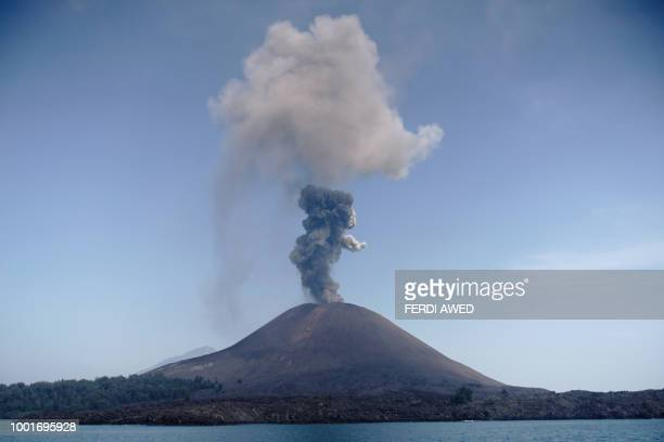 In this photo taken on July 18 A plume of ash rises from Anak Krakatau volcano as seen from Rakata island in South Lampung An Indonesian volcano...