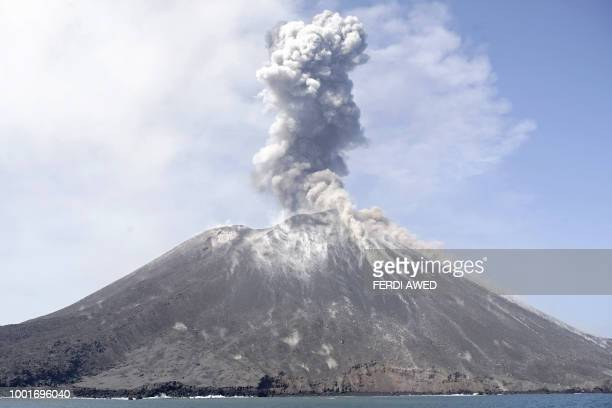 TOPSHOT In this photo taken on July 18 A plume of ash rises from Anak Krakatau volcano as seen from Rakata island in South Lampung An Indonesian...