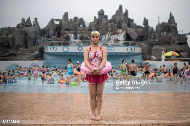 TOPSHOT In this photo taken on July 21 swimmer Ri SongHui poses for a portrait at the Munsu Water Park in Pyongyang / AFP PHOTO / Ed JONES