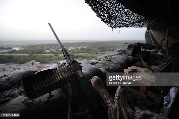 In this photo taken on July 29 2011 a soldier's feet rest on the 50 caliber machine gun mounted on the observation post of the US Combined Task Force...
