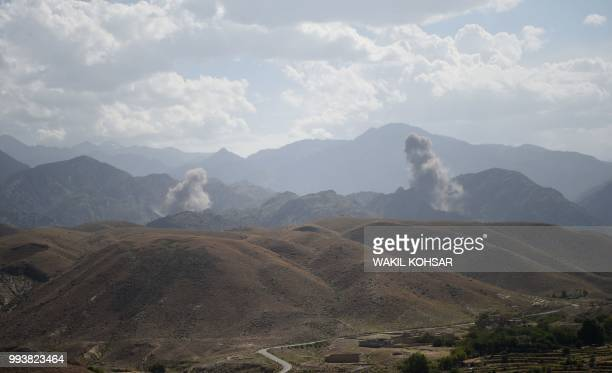 In this photo taken on July 7 smoke rises after an air strike bomb on Islamic State militants positions in a checkpoint at the Deh Bala district in...