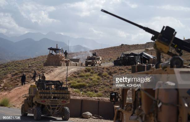 In this photo taken on July 7 US Army from NATO and Afghan commando forces are pictures in a checkpoint during a patrol against Islamic State...