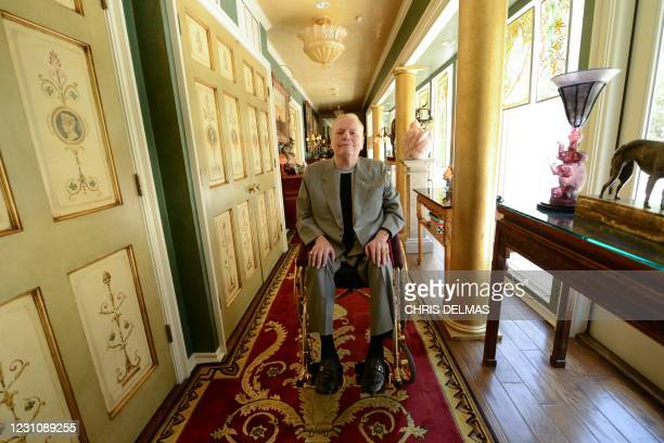 In this photo taken on June 11, 2014 publisher of Hustler magazine Larry Flynt poses at his house in Los Angeles. - US porn mogul Larry Flynt, best...
