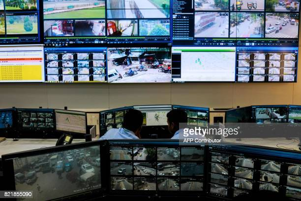 In this photo taken on June 14 Indian police officials work inside the 'Abhay' Police Command Control Centre at Jaipur Commissionate Headquarters in...