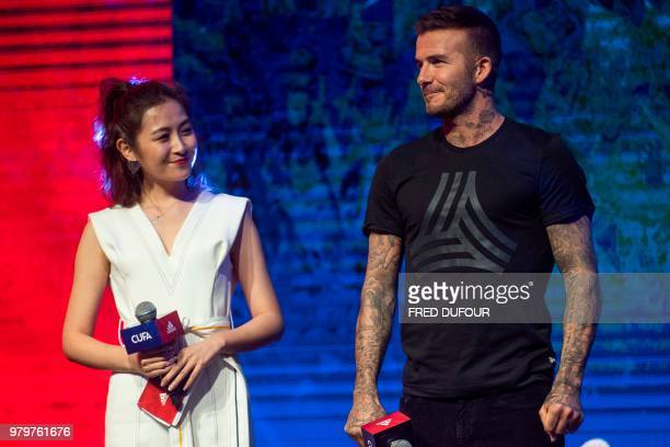 In this photo taken on June 20 former England footballer David Beckham attends a promotional event for a sportswear company and a collegiate football...