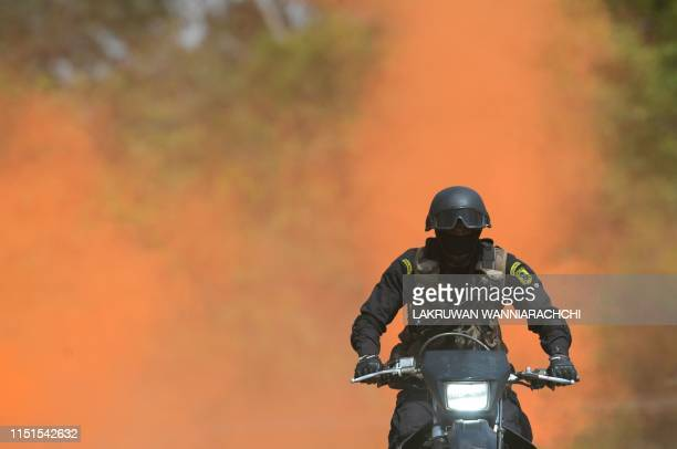 In this photo taken on June 22 2019 a Sri Lankan Special Forces soldier performs as he demonstrates his skills at Maduroya Special Forces training...