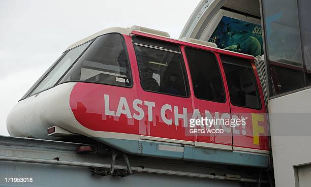 In this photo taken on June 28 2013 the Sydney Monorail makes its way into a stop at Sydney's Darling Harbour tourist precinct Sydney will on June 30...