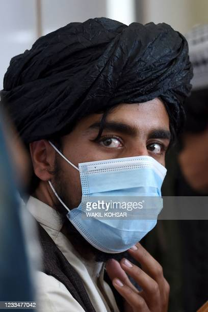 In this photo taken on June 3 a Taliban fighter attends a first-aid training class organised by the International Committee of the Red Cross , at a...