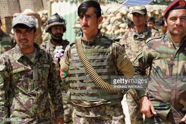 In this photo taken on June 6 Afghan National Army soldiers look on during a visit of commander of US and NATO forces in Afghanistan General Scott...