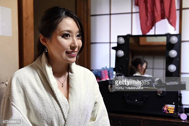 STORY 'JAPANSEXPORNOGRAPHYENTERTAINMENTMEN' FEATURE In this photo taken on March 14 adult video actress Yuko Shiraki answers questions during an...