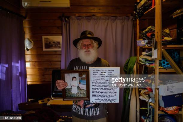 TOPSHOT In this photo taken on March 19 2019 in Lyttelton close to Christchurch local resident John Milne weeps as he stands in the bedroom of his...
