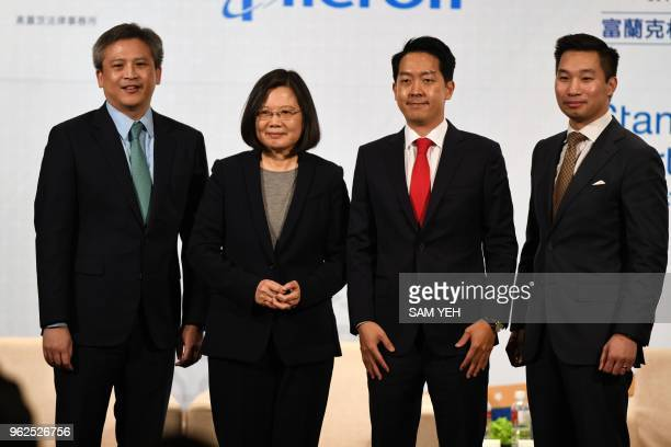 In this photo taken on March 21 Taiwan President Tsai Ingwen poses with American Institute in Taiwan director Kin Moy AmCham Taipei chairman Albert...