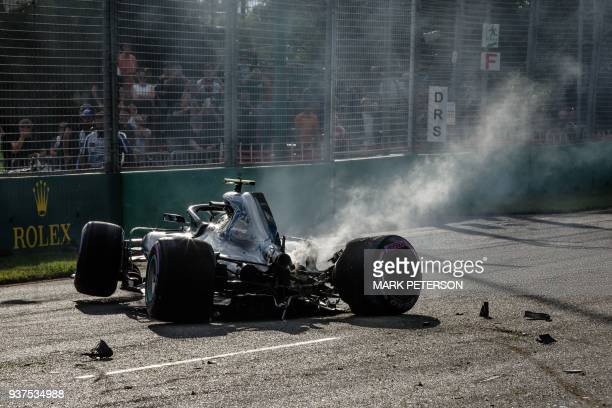 TOPSHOT In this photo taken on March 24 2018 Mercedes Finnish driver Valtteri Bottas crashes his car at the Albert Park circuit during qualifying for...